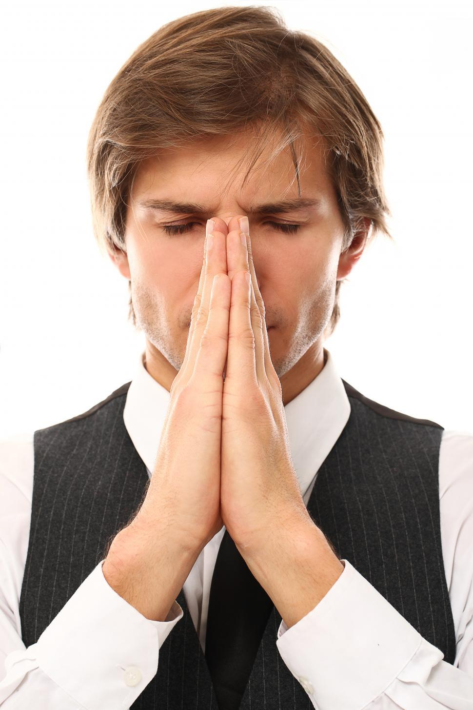 Download Free Stock Photo of Man with hands together as if in prayer
