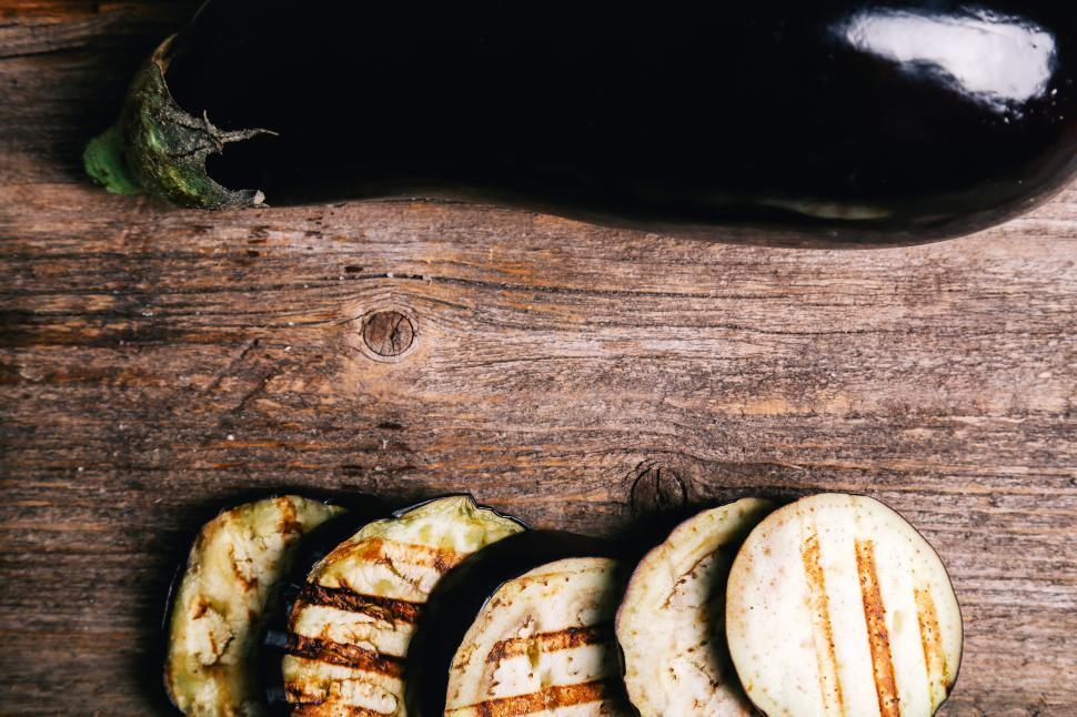 Download Free Stock Photo of Eggplant, whole and sliced with copyspace