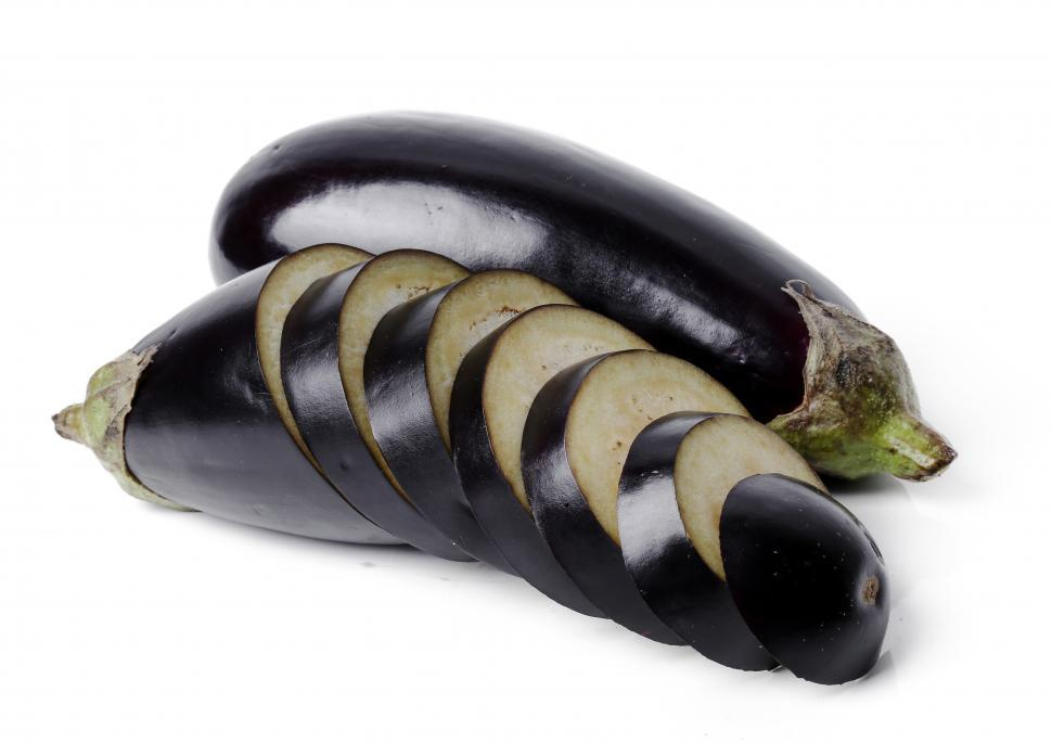 Download Free Stock Photo of Eggplants. One whole and one sliced.