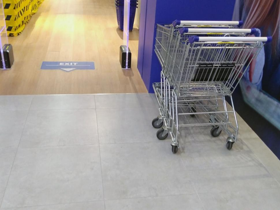 Download Free Stock Photo of Shopping trollies outside a store