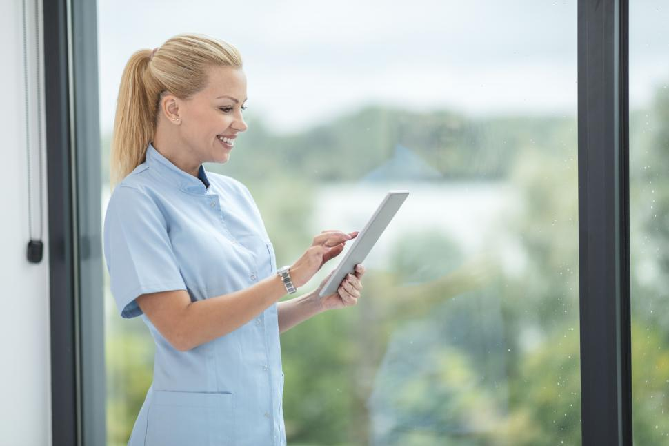Download Free Stock Photo of Female medical staff with tablet computer