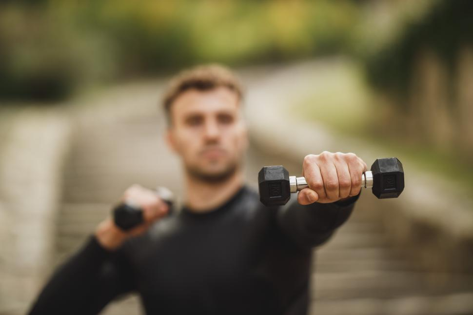 Download Free Stock Photo of Young man with dumbbells