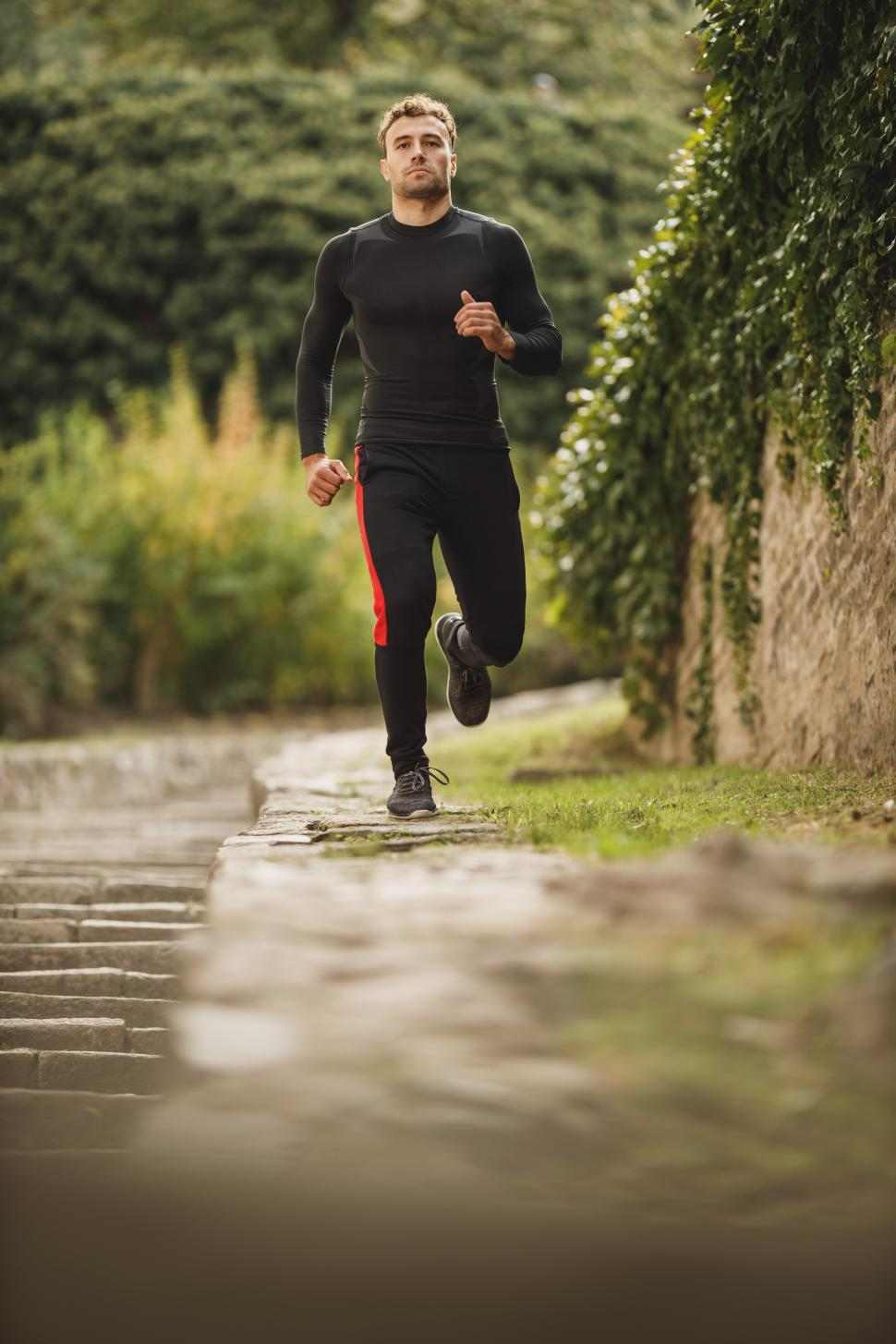 Download Free Stock Photo of Male athlete running in the park - looking at camera