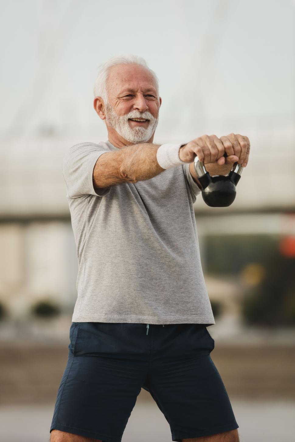 Download Free Stock Photo of Senior old man with dumbbell