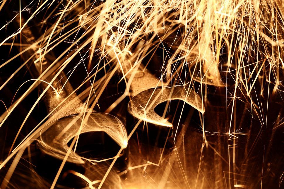Download Free Stock Photo of Sparks fly over metal tools
