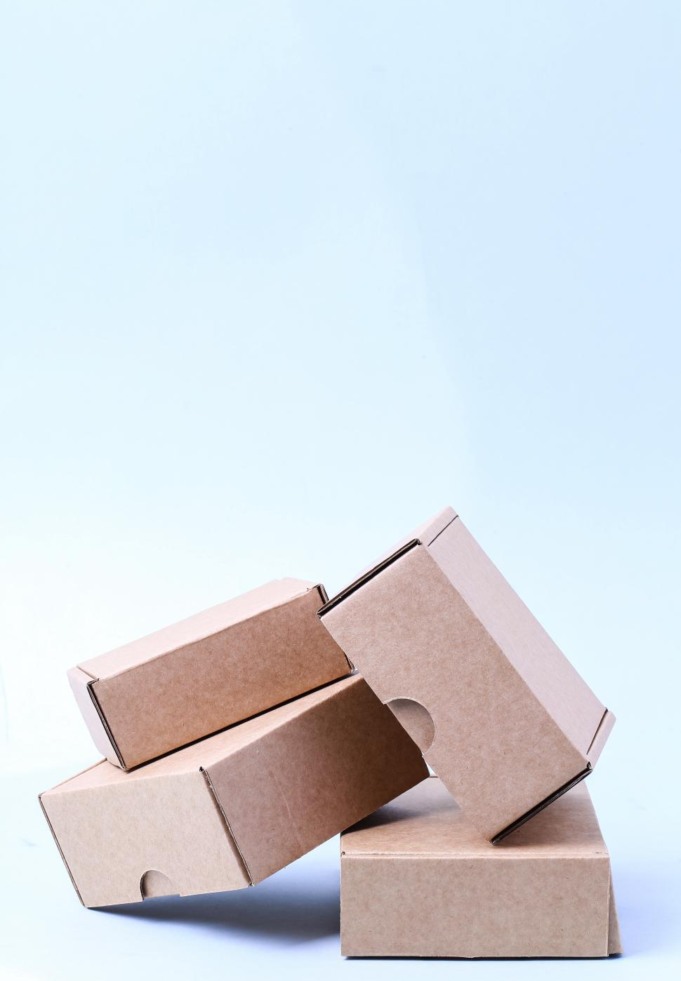 Download Free Stock Photo of Pile of cardboard boxes