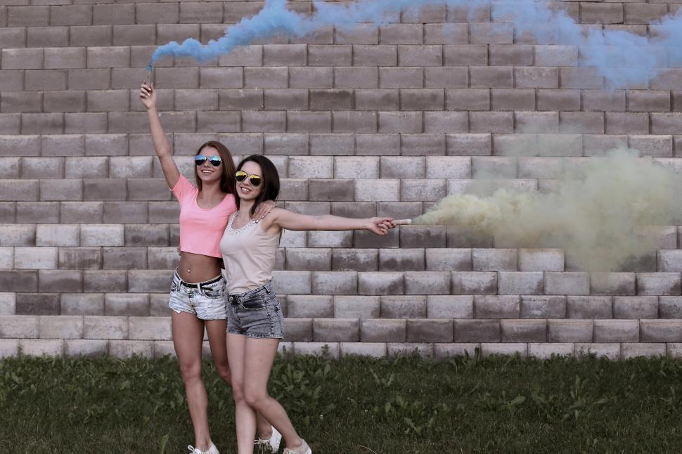 Download Free Stock Photo of Two Woman with Colorful Smoke Sticks