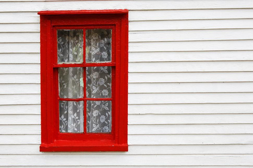 Download Free Stock Photo of Red window frame on white exterior wall