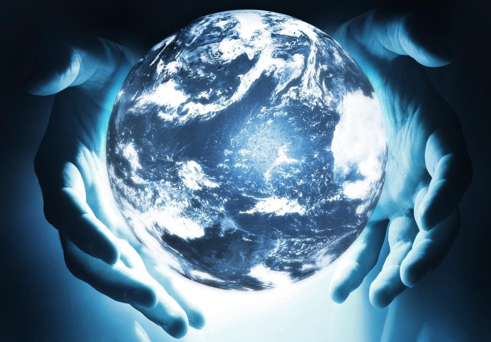 Download Free Stock Photo of Glowing earth sphere in hands