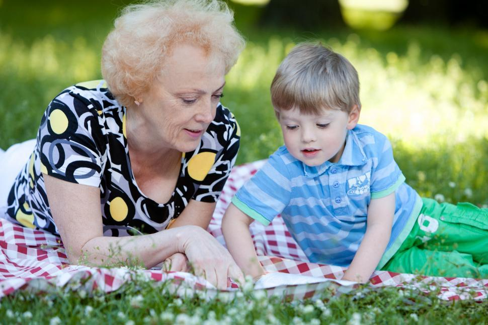 Download Free Stock Photo of Grandmother with her grandson in the park