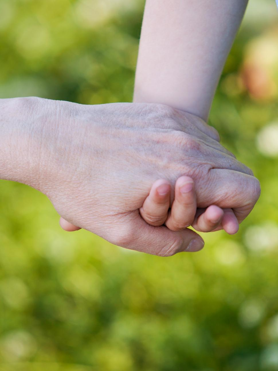 Download Free Stock Photo of Hands of grandson and grandmother together
