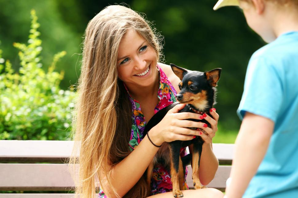 Download Free Stock Photo of Young woman showing her small doggy