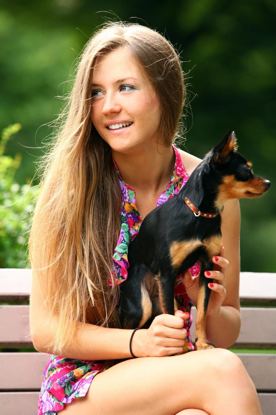 Download Free Stock Photo of Young and happy girl with her cute dog