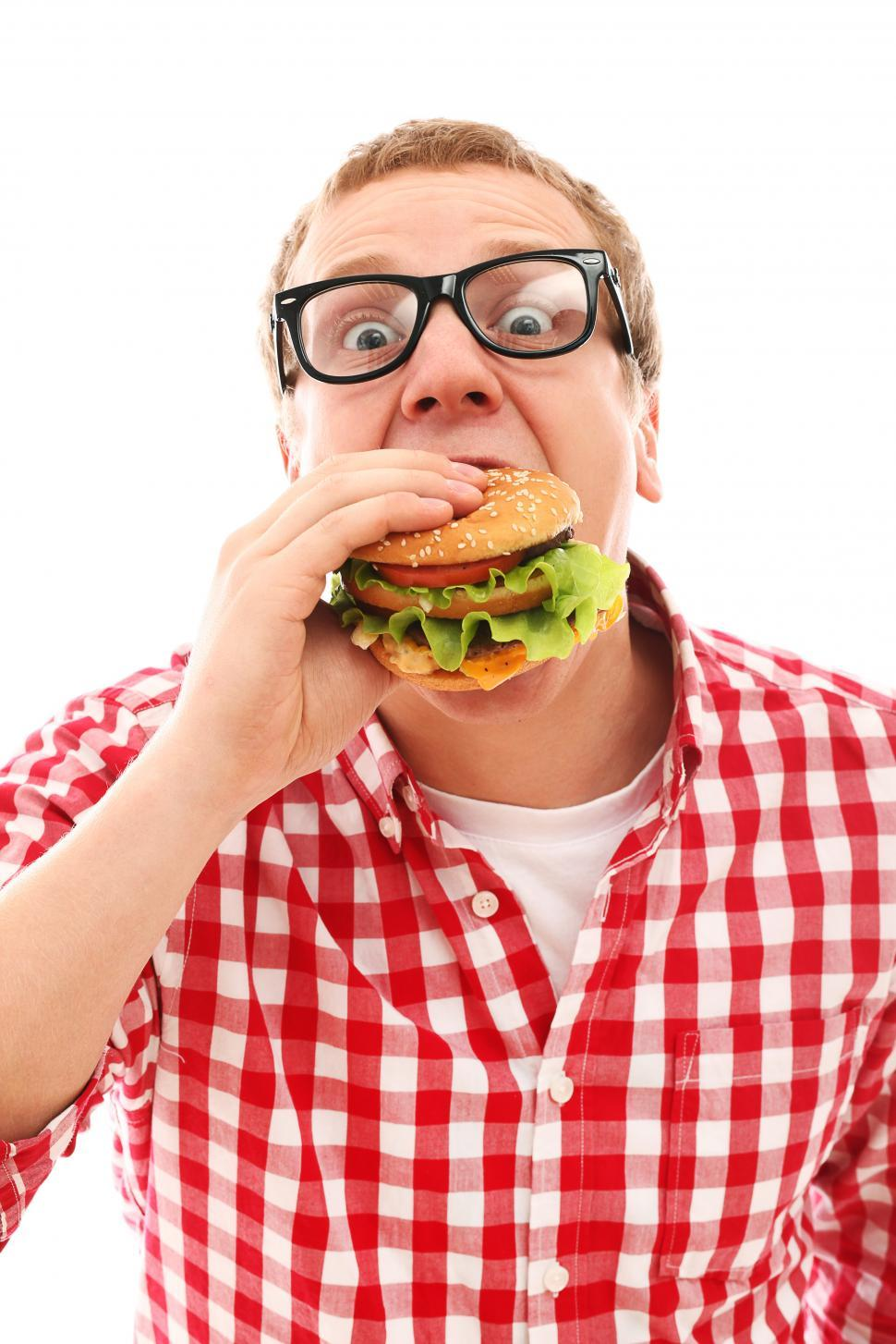 Download Free Stock Photo of Man in plaid attacking a hamburger