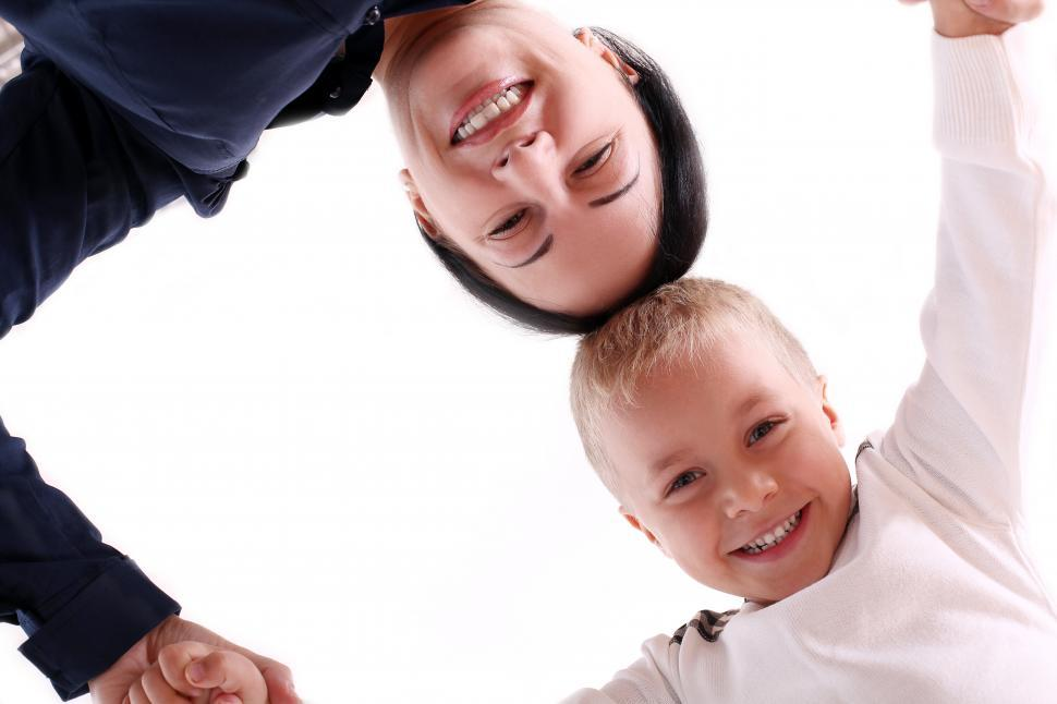Download Free Stock Photo of Mother and child with heads together, looking down