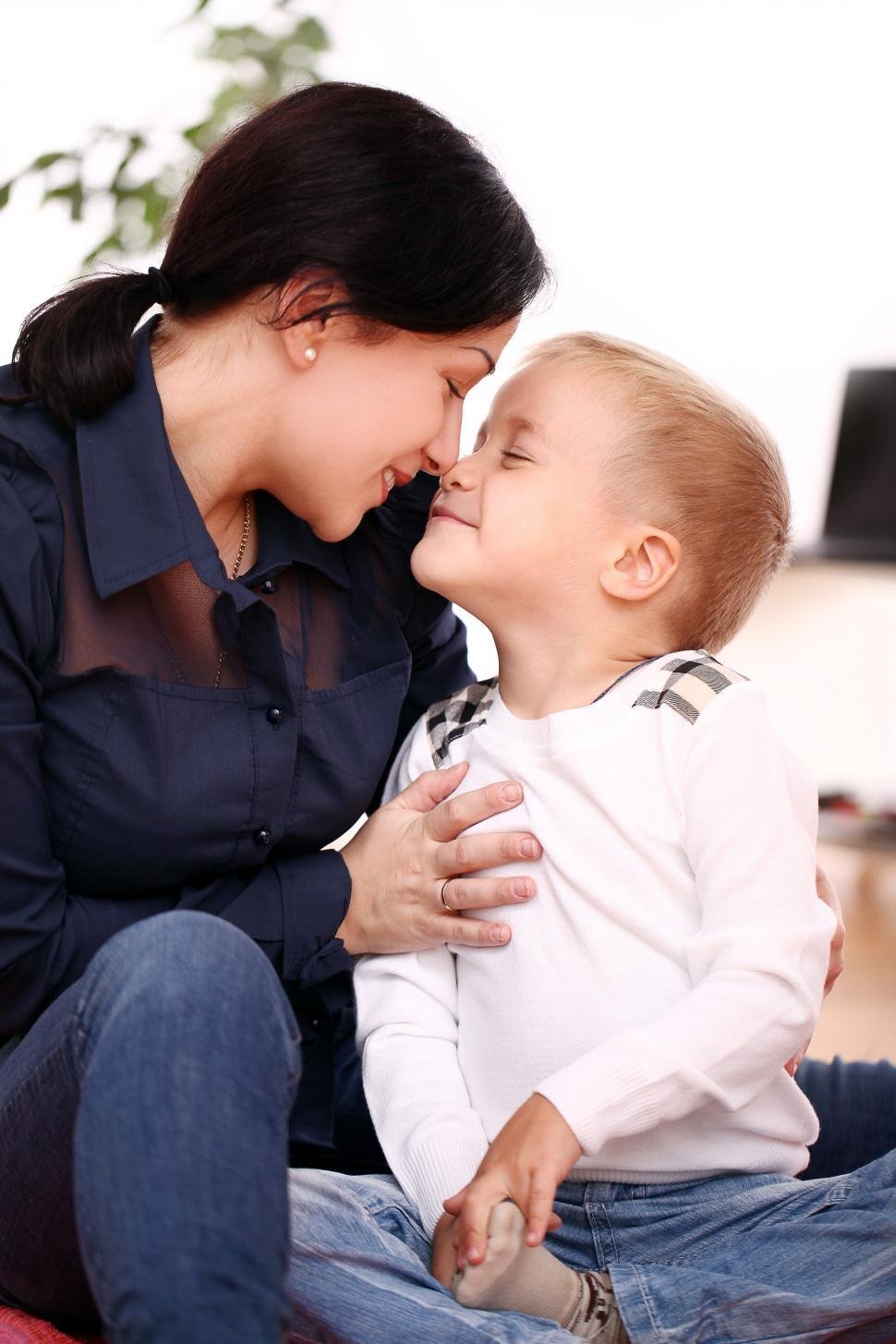 Download Free Stock Photo of Mother affectionately rubs noses with her child