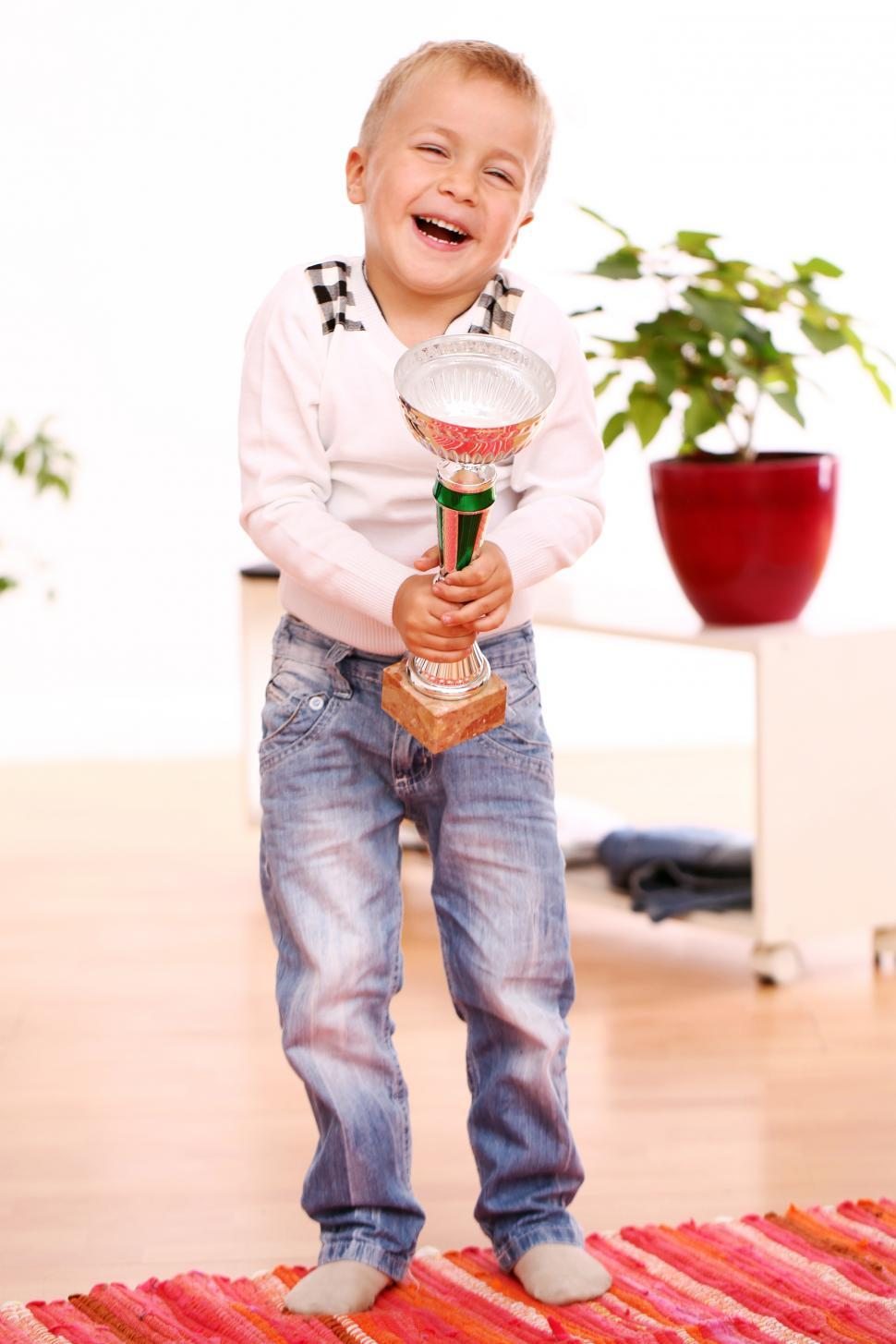 Download Free Stock Photo of Kid is excited to win a trophy
