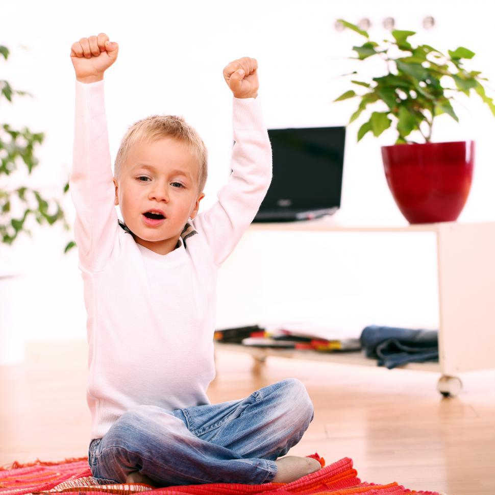 Download Free Stock Photo of LIttle kids raising arms in victory