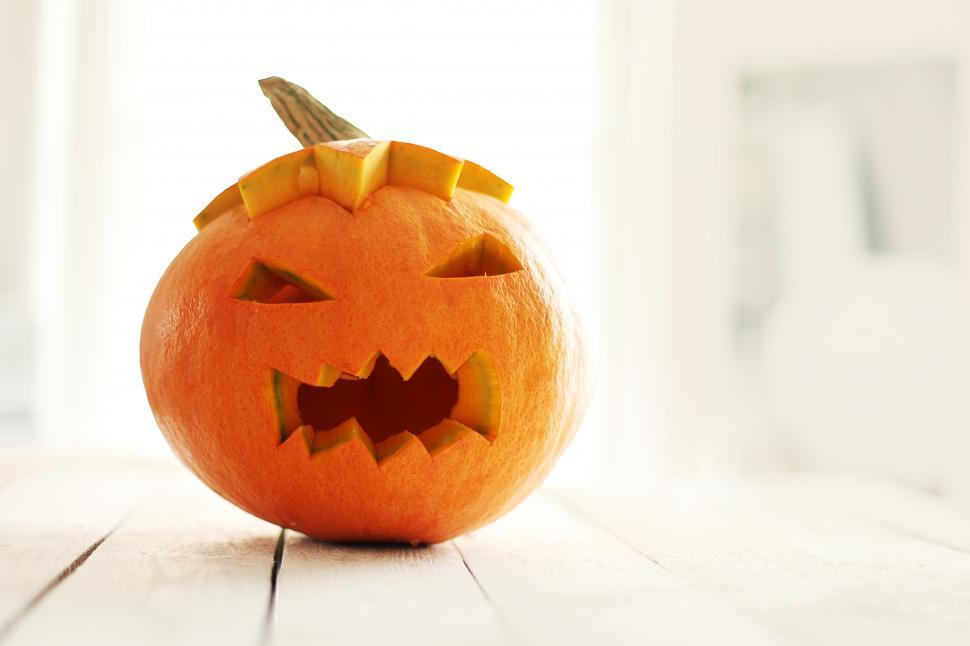 Download Free Stock Photo of Carved pumpkin with scary face