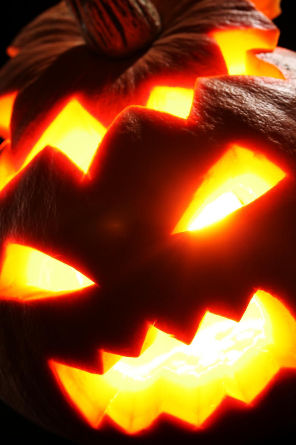 Download Free Stock Photo of Close up of scary glowing jack o lantern face