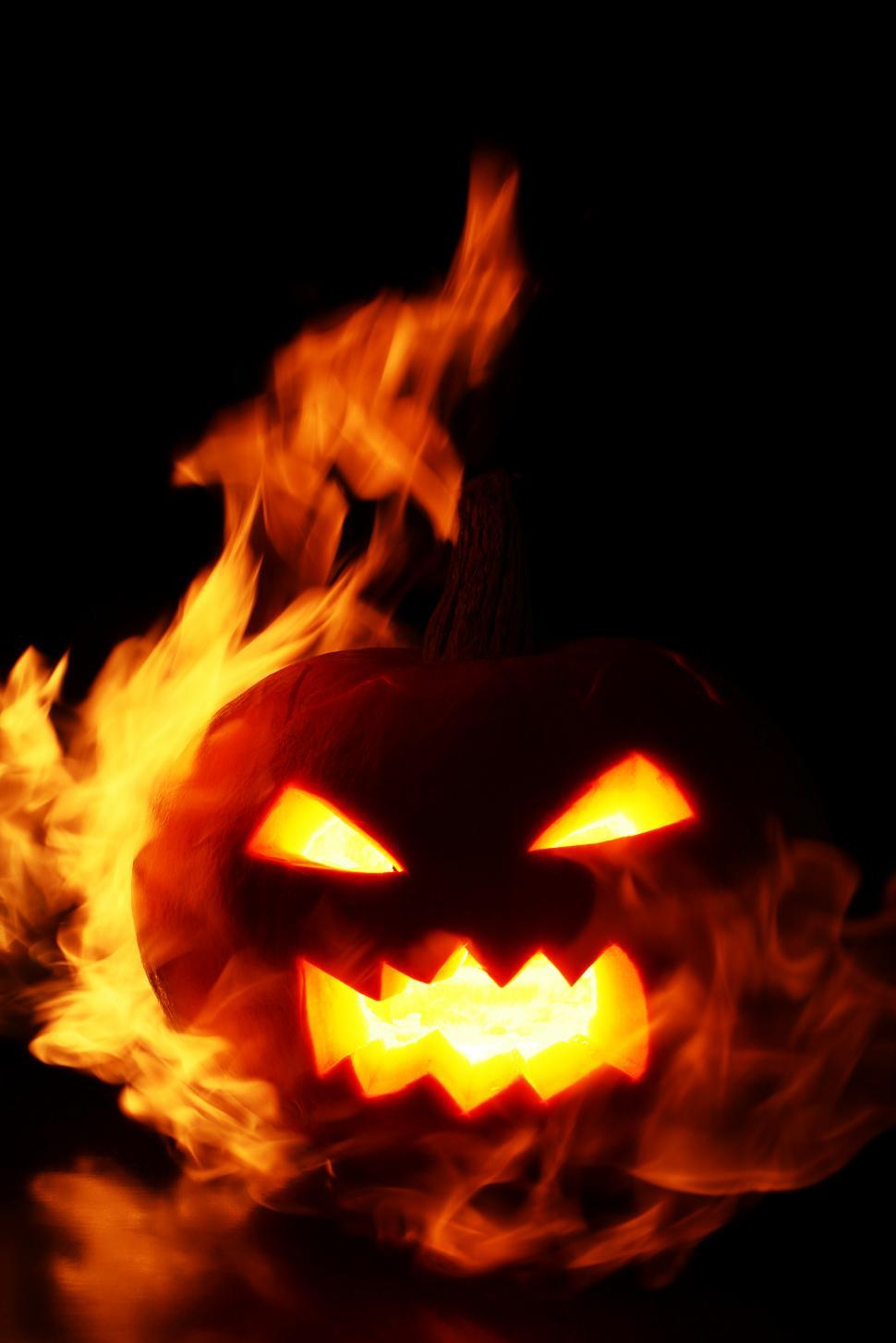Download Free Stock Photo of Carved pumpkin engulfed in flames
