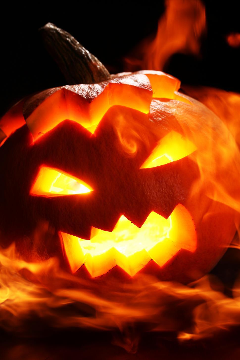 Download Free Stock Photo of Dark scene with bright, flaming jack o lantern