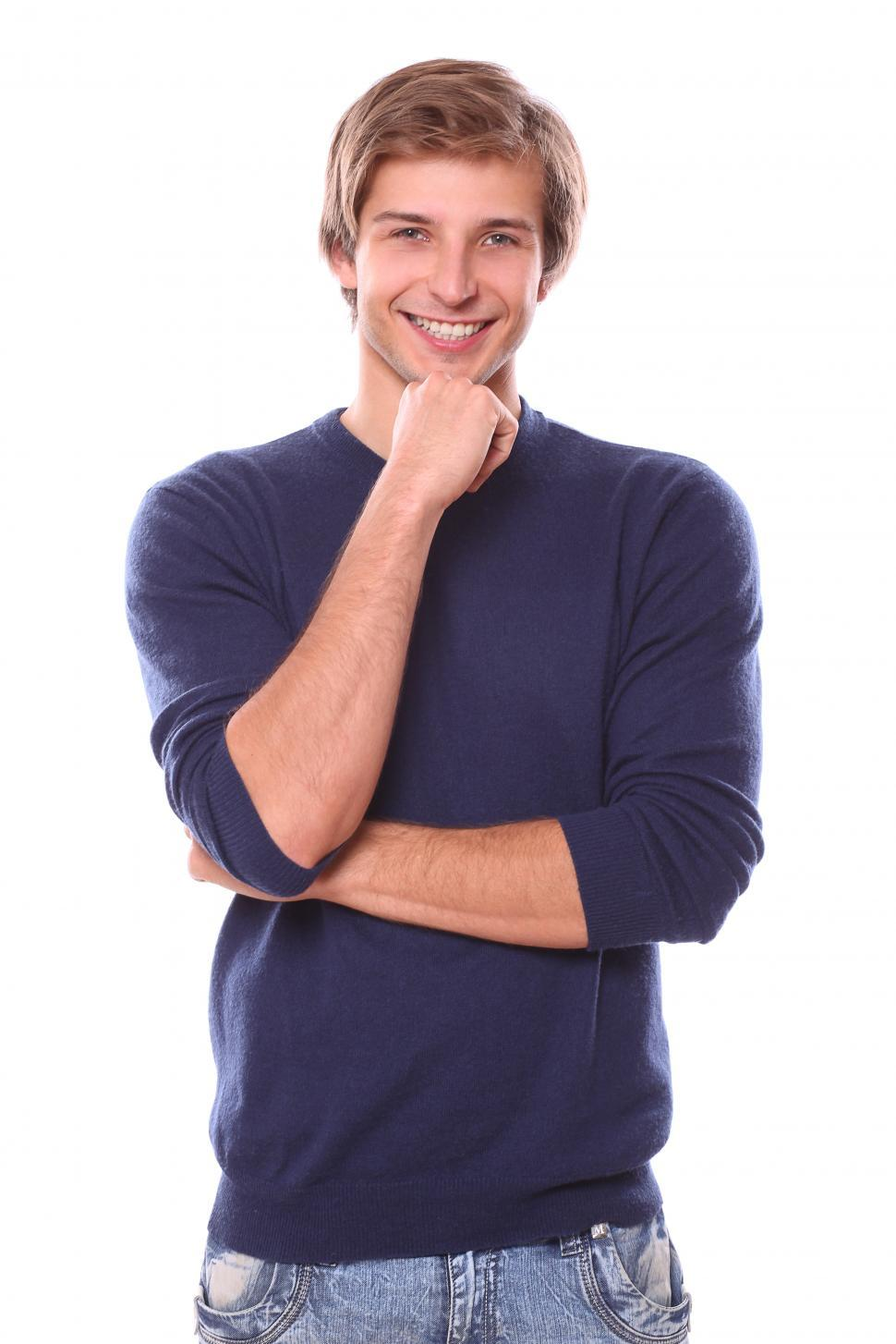 Download Free Stock Photo of Pleasant attractive looking man with chin in hand