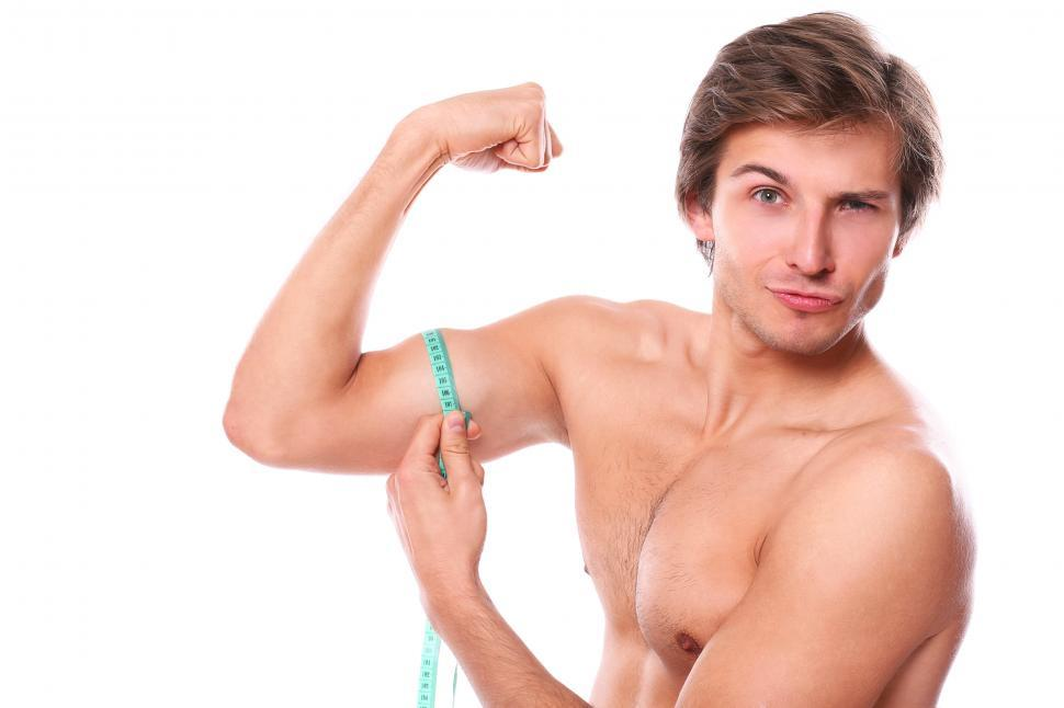 Download Free Stock Photo of Guy being goofy, measuring his muscles