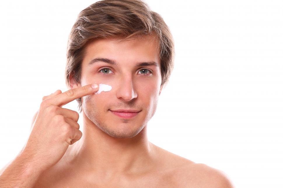 Download Free Stock Photo of Man applying face cream