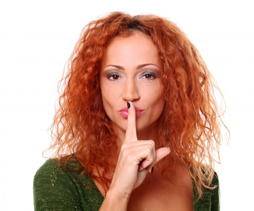 Download Free Stock Photo of Woman with her finger to her lips, shushing, looking at camera