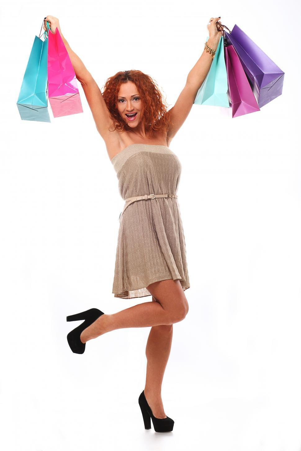 Download Free Stock Photo of Woman hoisting several shopping bags