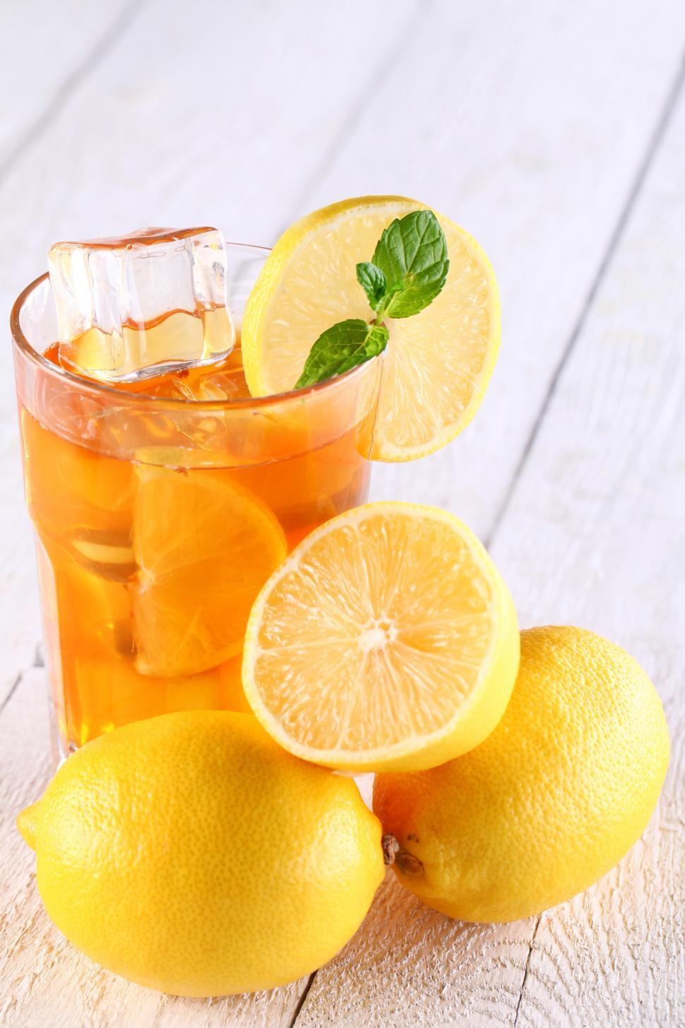 Download Free Stock Photo of Glass of fresh iced tea and lemons