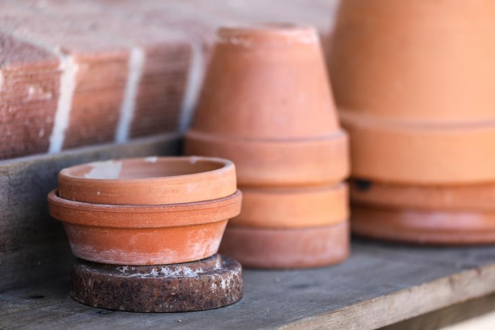 Download Free Stock Photo of Terra Cotta pots on a shelf