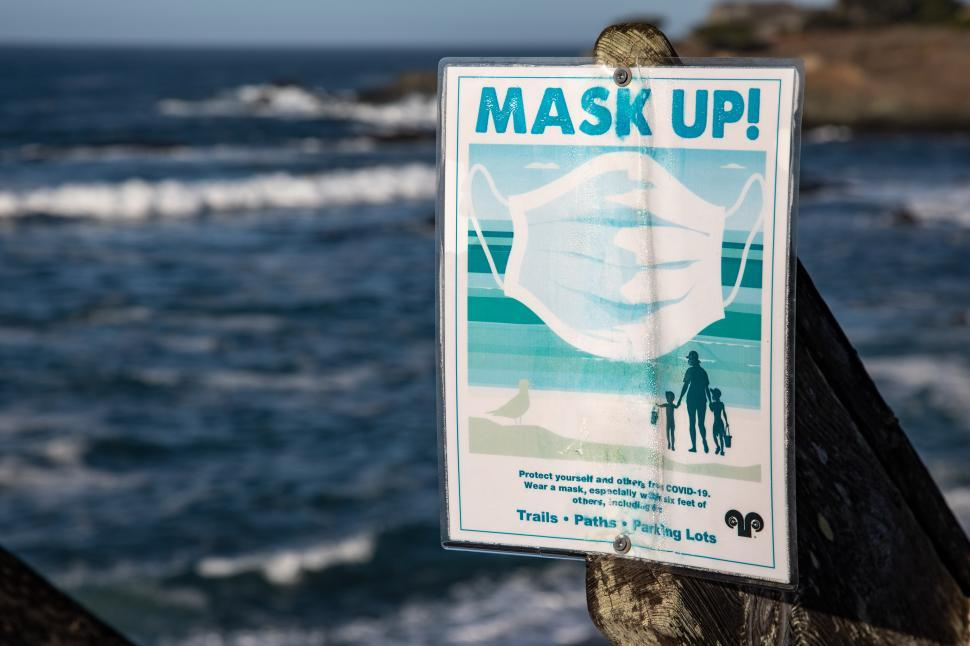 Download Free Stock Photo of Sign instructing people to weark masks