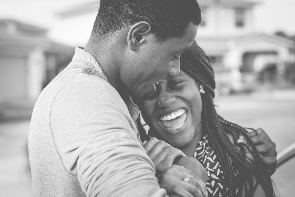 Download Free Stock Photo of Young urban couple holding each other - happy couple
