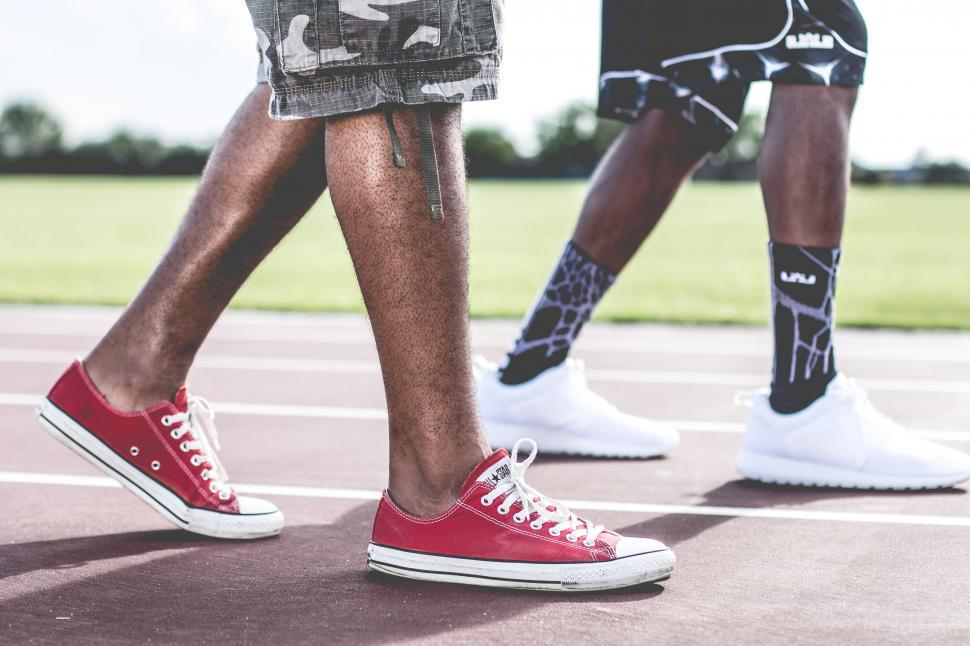 Download Free Stock Photo of Two men walking in sneakers
