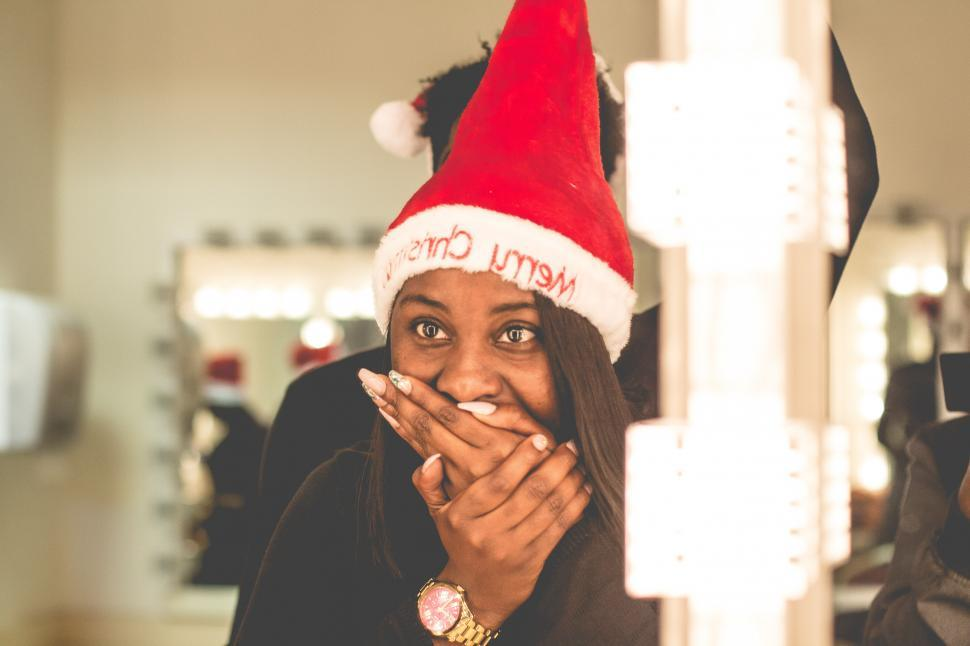 Download Free Stock Photo of Surprised Woman in Christmas hat - face on mouth