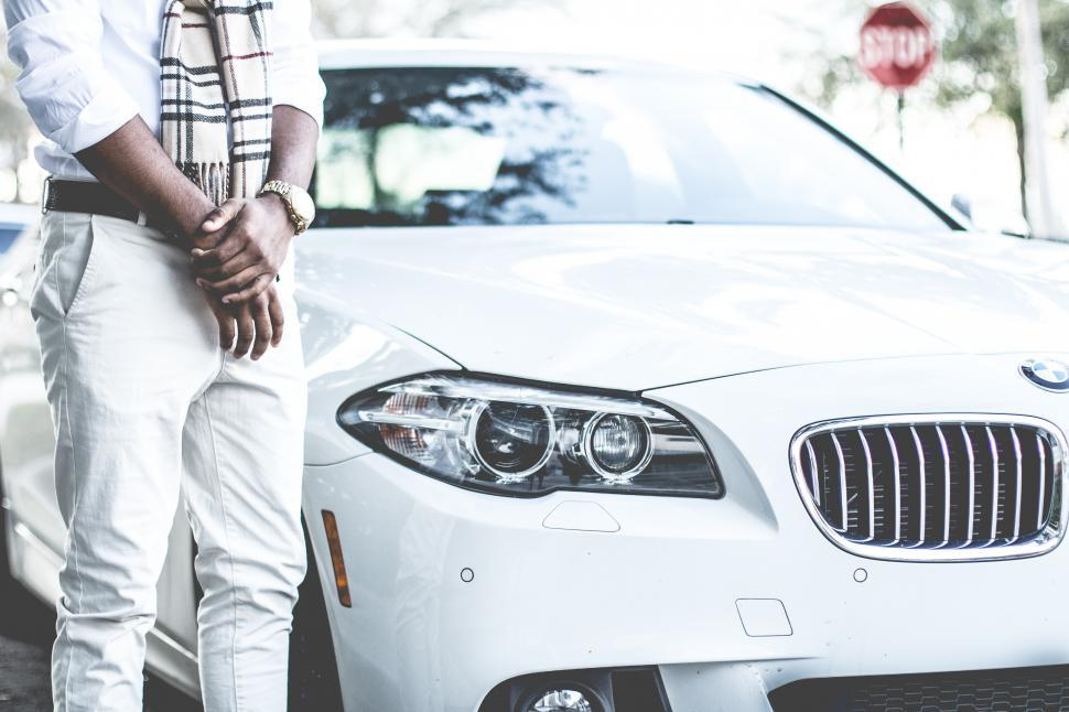 Download Free Stock Photo of Stylish man with white BMW car