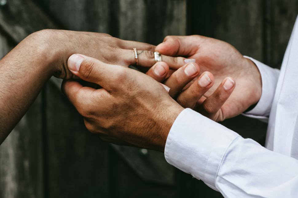 Download Free Stock Photo of Couple hands with wedding rings
