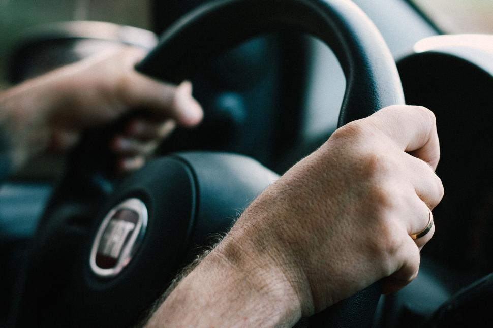 Download Free Stock Photo of Hands on steering wheel