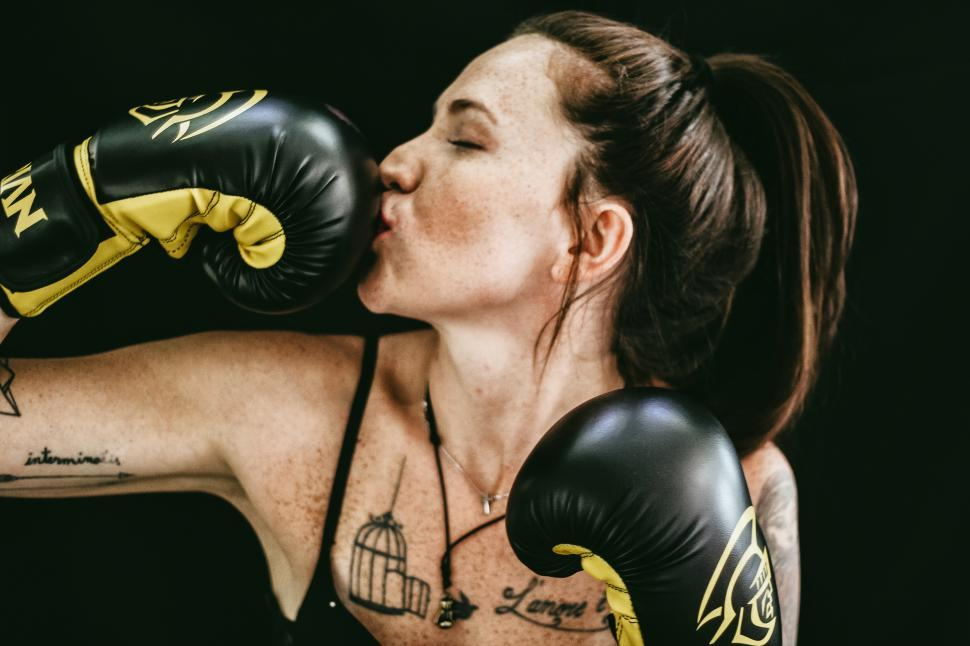 Download Free Stock Photo of Female boxer with black boxing gloves