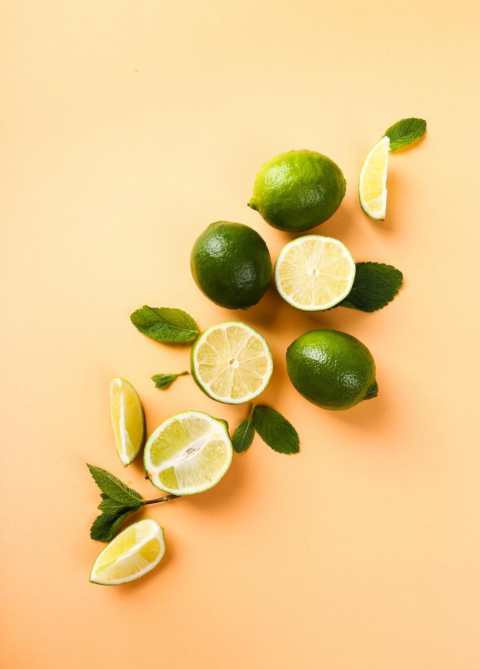 Download Free Stock Photo of Sliced and while limes