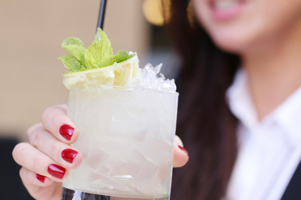 Download Free Stock Photo of Woman with a cocktail