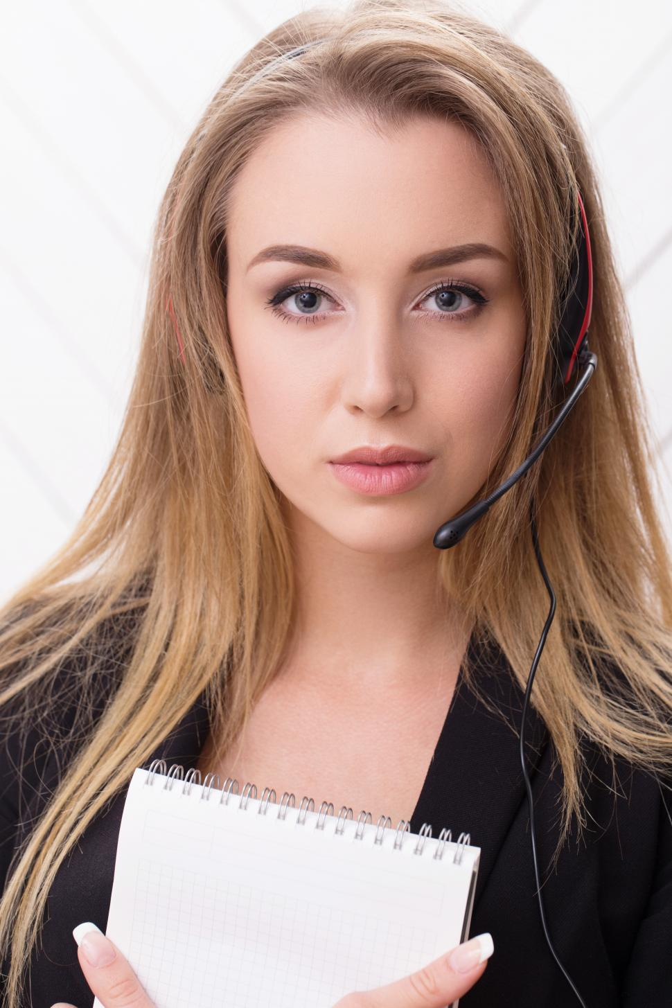 Download Free Stock Photo of Woman with a headset