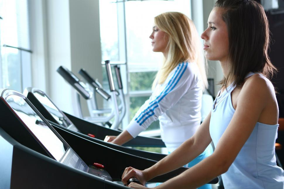 Download Free Stock Photo of Young woman training at the gym