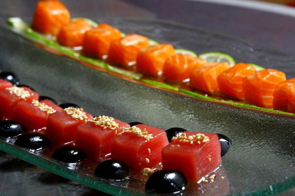 Download Free Stock Photo of Fresh salmon and a tuna sushi with sauces
