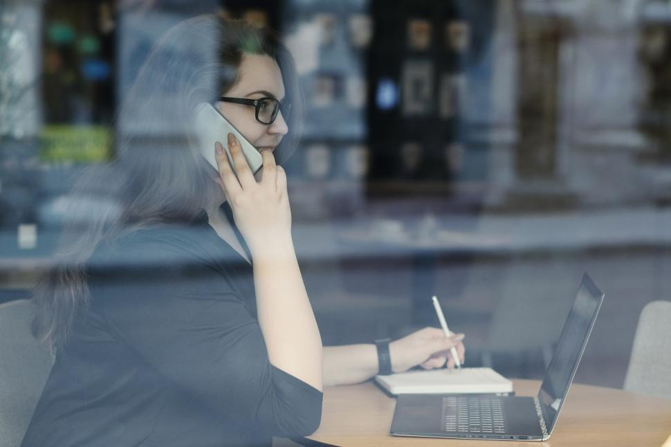 Download Free Stock Photo of Woman on the phone, through window