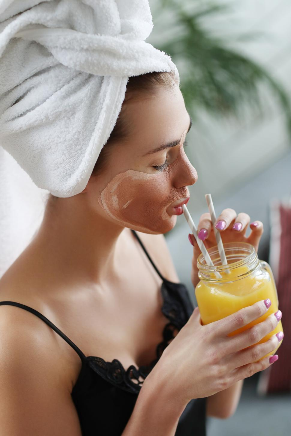 Download Free Stock Photo of Woman with juice at a spa