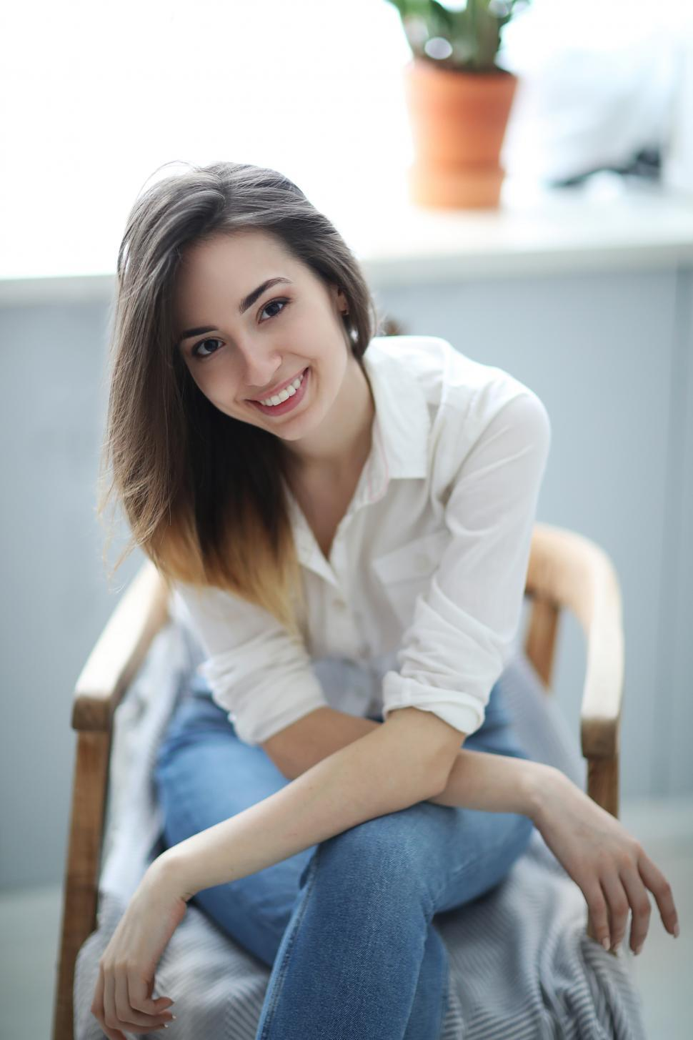 Download Free Stock Photo of Casual woman in chair at home