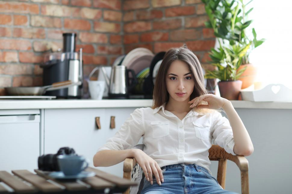 Download Free Stock Photo of Woman in cafe, looking at the camera